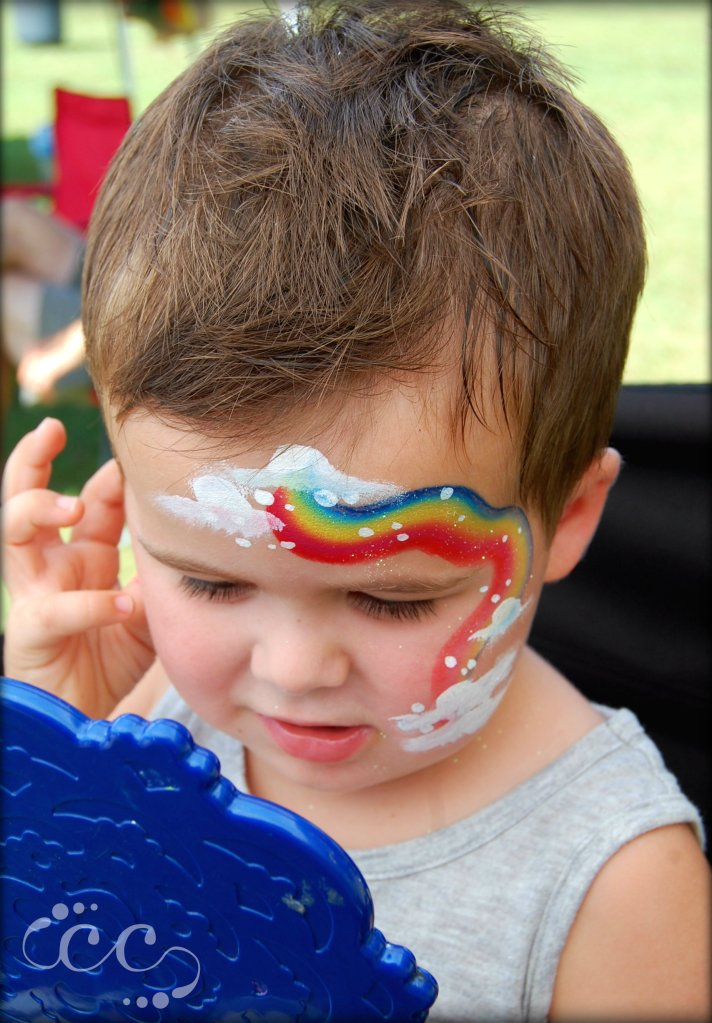 rainbow boy with logo